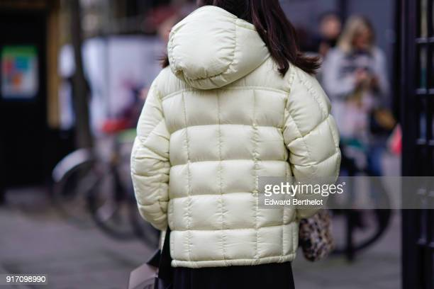 A guest wears a white puffer jacket during London Fashion Week Men's January 2018 at on January 6 2018 in London England