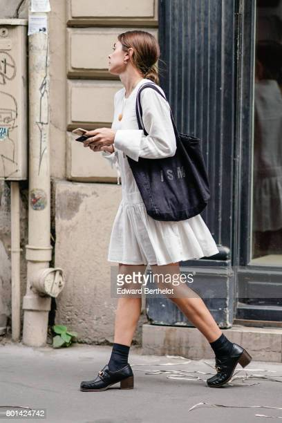 Guest wears a white ruffled dress, outside the Thom Browne show, during Paris Fashion Week - Menswear Spring/Summer 2018, on June 25, 2017 in Paris,...