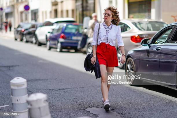 A guest wears a white shirt a red skirt outside Wooyoungmi during Paris Fashion Week Menswear SpringSummer 2019 on June 23 2018 in Paris France