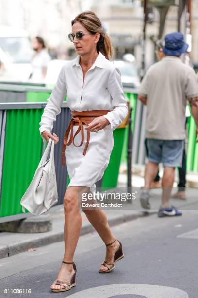 A guest wears a white shirt a white bag outside the Elie Saab show during Paris Fashion Week Haute Couture Fall/Winter 20172018 on July 5 2017 in...