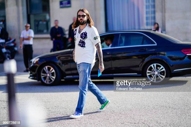 A guest wears a white shirt blue jeans blue and green sneakers shoes outside Dries Van Noten during Paris Fashion Week Menswear SpringSummer 2019 on...