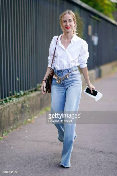 A guest wears a white shirt blue jeans outside CDG Comme des Garcons during Paris Fashion Week Womenswear Spring/Summer 2018 on September 30 2017 in...