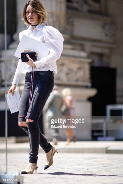 A guest wears a white shirt ripped jeans chanel shoes outside the Chanel show during Paris Fashion Week Haute Couture Fall/Winter 20172018 on July 4...