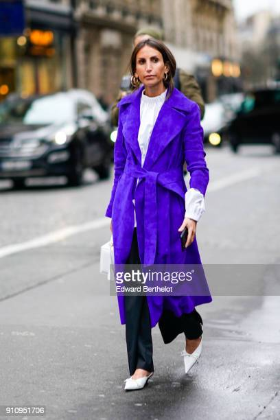 A guest wears a white top a purple coat white shoes outside Alexis Mabille during Paris Fashion Week Haute Couture Spring/Summer 2018 on January 23...