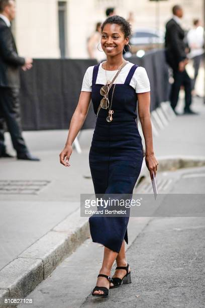 A guest wears a white tshirt and a blue dress outside the Valentino show during Paris Fashion Week Menswear Spring/Summer 2018 on June 21 2017 in...