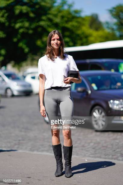 A guest wears a white tshirt gray leggings shorts black boots outside OffWhite during Paris Fashion Week Menswear SpringSummer 2019 on June 20 2018...