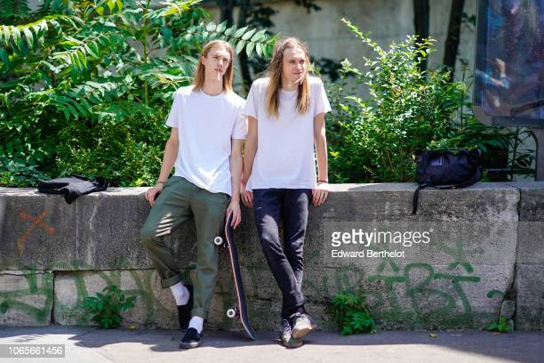 A guest wears a white tshirt outside Rick Owens during Paris Fashion Week Menswear SpringSummer 2019 on June 21 2018 in Paris France