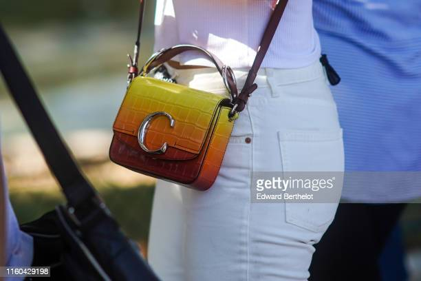 A guest wears a yellow and orange Chloe bag outside Alexandre Vauthier during Paris Fashion Week Haute Couture Fall/Winter 2019/2020 on July 02 2019...