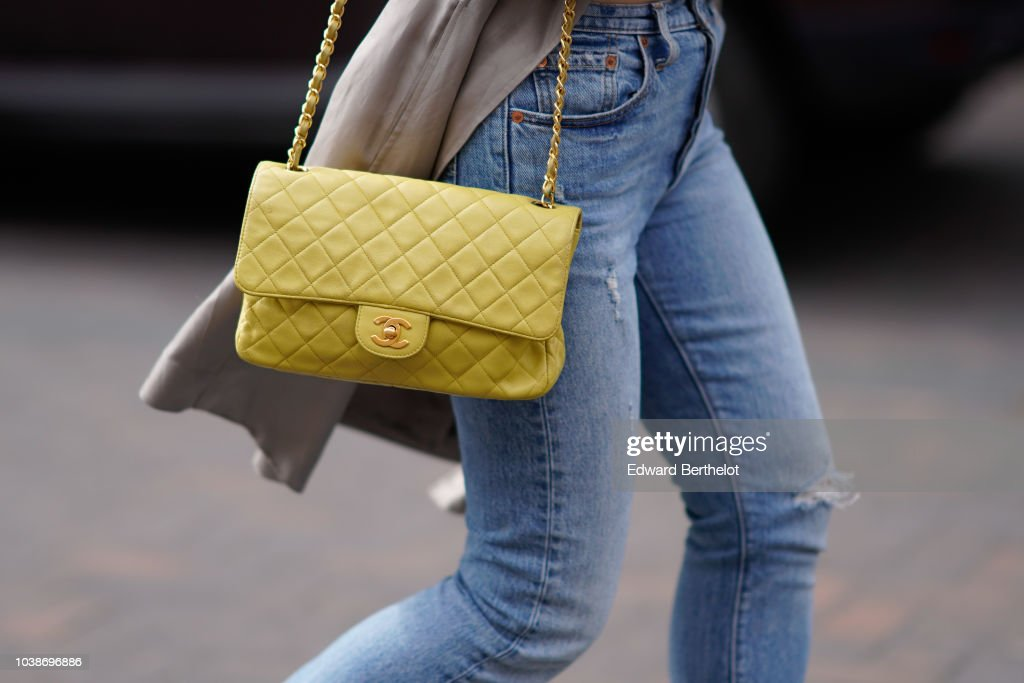 A Guest Wears Yellow Chanel Bag