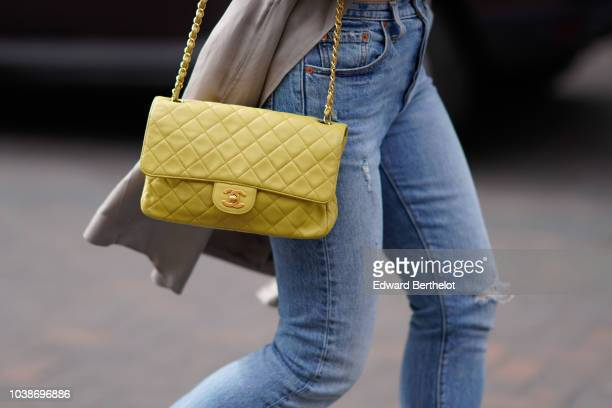 A guest wears a yellow Chanel bag during London Fashion Week September 2018 on September 16 2018 in London England
