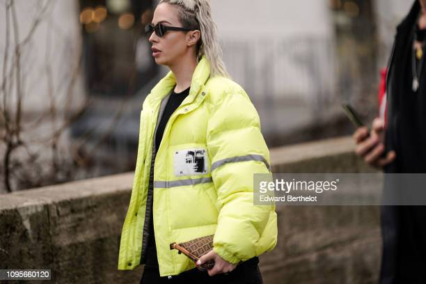 A guest wears a yellow puffer jacket outside Rick Owens during Paris Fashion Week Menswear F/W 20192020 on January 17 2019 in Paris France