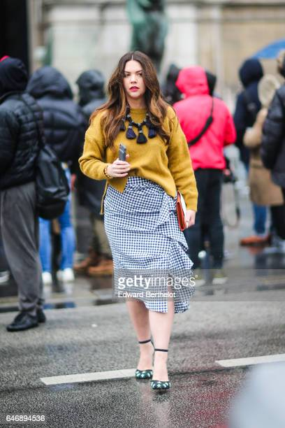 A guest wears a yellow top and a black and white skirt outside the Lanvin show during Paris Fashion Week Womenswear Fall/Winter 2017/2018 on March 1...