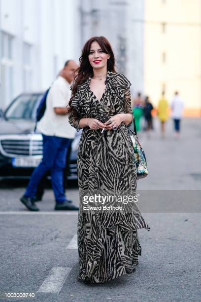 Guest wears a zebra print dress , during Feeric Fashion Week 2018, on July 20, 2018 in Sibiu, Romania.