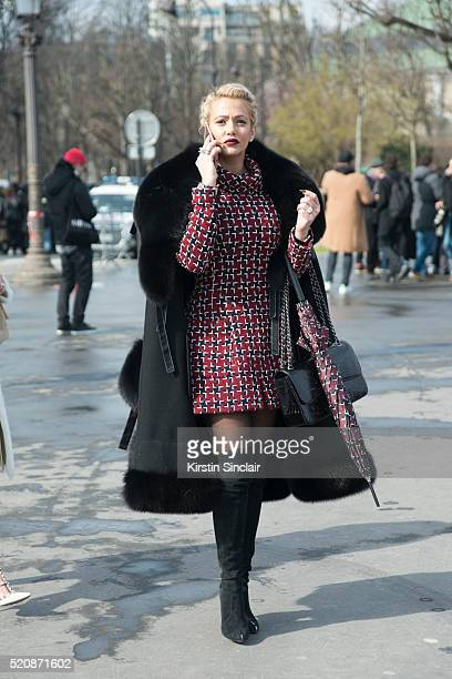 A guest wears all Chanel on day 8 during Paris Fashion Week Autumn/Winter 2016/17 on March 8 2016 in Paris France A guest