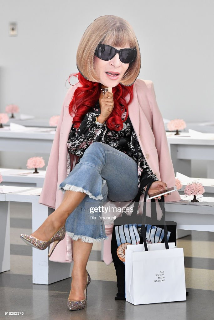 A guest wears an Anna Wintour cut out at the Leanne Marshall front row during New York Fashion Week: The Shows at Gallery II at Spring Studios on February 14, 2018 in New York City.