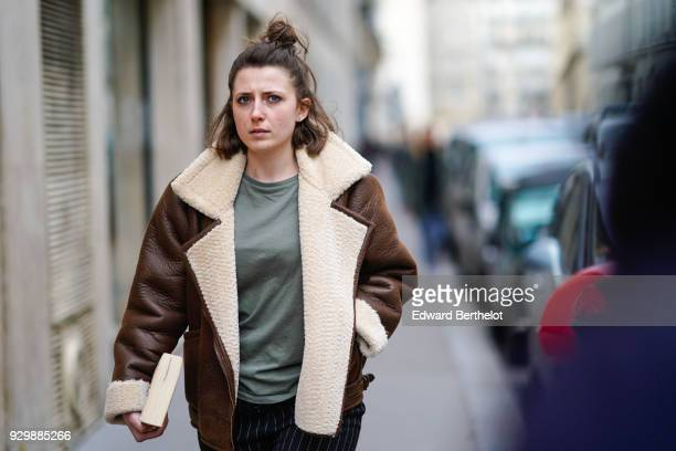 A guest wears an aviator jacket outside APC during Paris Fashion Week Womenswear Fall/Winter 2018/2019 on March 5 2018 in Paris France