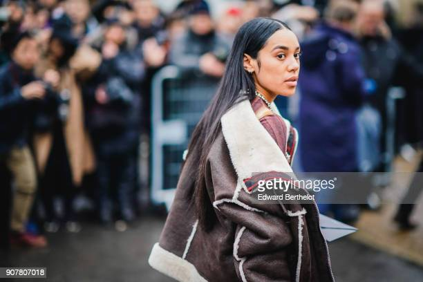 A guest wears an aviator jacket outside Dior during Paris Fashion Week Menswear Fall Winter 20182019 on January 20 2018 in Paris France