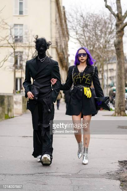Guest wears an integral black face mask/hood, covering the entire head and neck, with attached lace and mesh parts, a metallic necklace, a black...