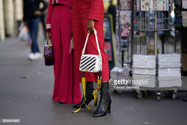 A guest wears an Off White bag outside Acne Studios during Paris Fashion Week Womenswear Spring/Summer 2018 on September 30 2017 in Paris France