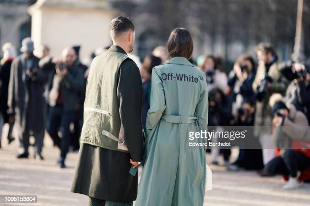 A guest wears an OffWhite green trench coat outside OffWhite during Paris Fashion Week Menswear F/W 20192020 on January 16 2019 in Paris France