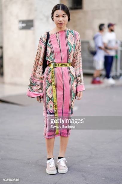 A guest wears an offwhite yellow belt a pink dress sneakers outside the 22/4 Hommes show during Paris Fashion Week Menswear Spring/Summer 2018 on...
