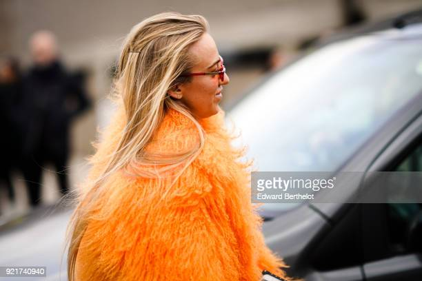 A guest wears an orange fur coat during London Fashion Week February 2018 on February 18 2018 in London England