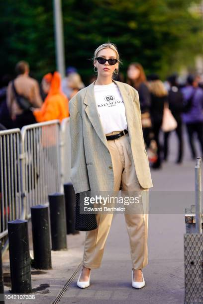 A guest wears an oversized blazer jacket a wite Balenciaga tshirt a belt beige pants outside Chloe during Paris Fashion Week Womenswear Spring/Summer...