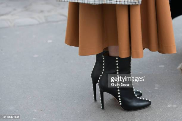 A guest wears Aquazurra pearl boots day 2 of Paris Womens Fashion Week Spring/Summer 2018 on February 27 2018 in London England