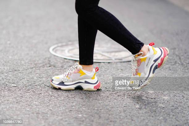 A guest wears Balenciaga sneakers shoes during London Fashion Week September 2018 on September 18 2018 in London England