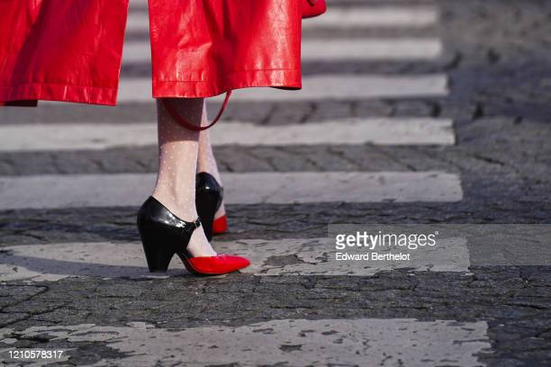 Guest wears black and white leather Chanel pointy shoes, outside Chanel, during Paris Fashion Week - Womenswear Fall/Winter 2020/2021 on March 03,...