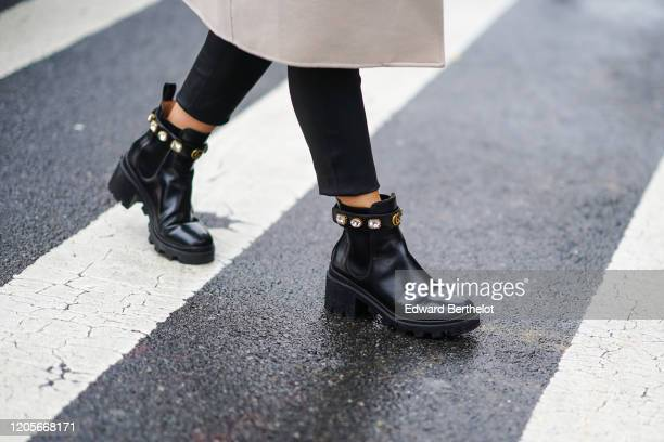 Guest wears black leather bejeweled shoes from Gucci, during New York Fashion Week Fall Winter 2020, on February 11, 2020 in New York City.