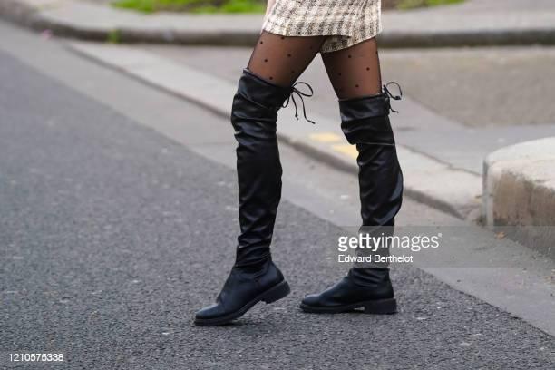 Guest wears black leather thigh high boots, outside Gauchere, during Paris Fashion Week - Womenswear Fall/Winter 2020/2021 on March 03, 2020 in...