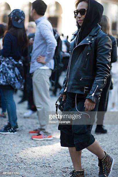 Guest wears black Lewis Leathers biker jacket and Valentino Sunglasses after Dior at Cour Carree Du Louvre during Paris Fashion Week Spring/Summer...