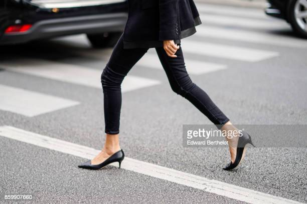 A guest wears black pants black shoes outside the Dries Van Noten show during Paris Fashion Week Womenswear Spring/Summer 2018 on September 27 2017...