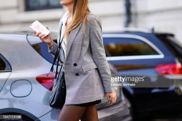 A guest wears blazer jacket outside Akris during Paris Fashion Week Womenswear Spring/Summer 2019 on September 30 2018 in Paris France