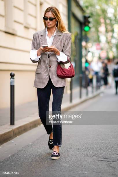 A guest wears blazer jacket outside Anrealage during Paris Fashion Week Womenswear Spring/Summer 2018 on September 26 2017 in Paris France