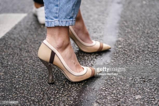 Guest wears blue crop jeans, beige and brown pointy heeled Fendi pumps, outside Giambattista Valli, during Paris Fashion Week - Womenswear...
