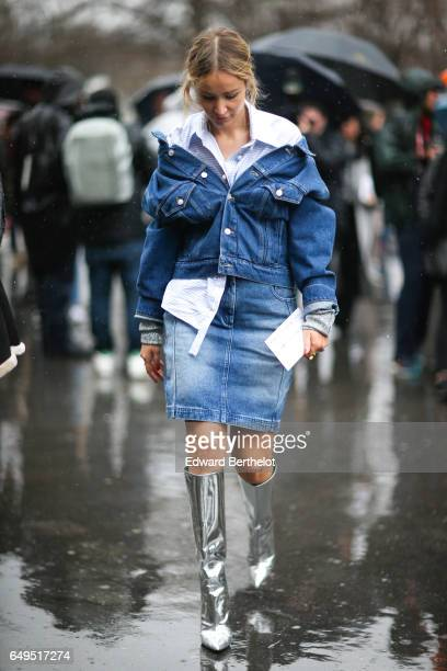 A guest wears blue denim jacket a blue denim skirt and silver boots outside the Elie Saab show during Paris Fashion Week Womenswear Fall/Winter...