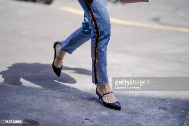 A guest wears blue jeans shoes outside Juun J during Paris Fashion Week Menswear SpringSummer 2019 on June 22 2018 in Paris France