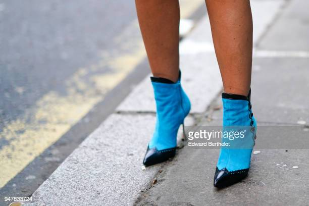 A guest wears blue shoes during London Fashion Week Men's January 2018 at on January 6 2018 in London England
