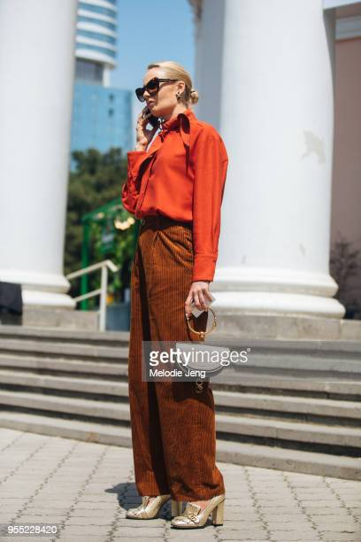 A guest wears brown corduroy pants a salmon top and Chloe bag on May 5 2018 in Tbilisi Georgia