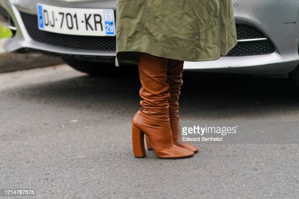 Guest wears brown leather high heel pointy boots, outside Loewe, during Paris Fashion Week - Womenswear Fall/Winter 2020/2021, on February 28, 2020...