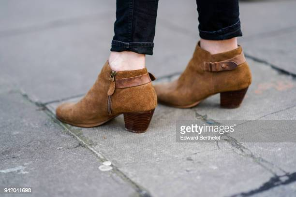 A guest wears brown shoes during London Fashion Week February 2018 on February 16 2018 in London England
