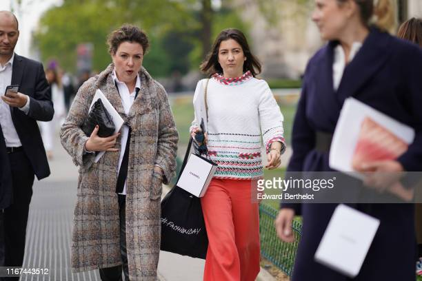 A guest wears Chanel earrings a white shirt a Chanel brown and grey fringed tweed coat a black Chanel clutch A guest wears a red and green trimmed...