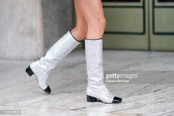 A guest wears Chanel gray silver glitter boots outside Stephane Rolland during Paris Fashion Week Haute Couture Spring Summer 2020 on January 22 2019...