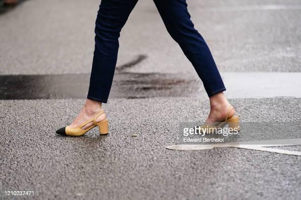 Guest wears Chanel slingback shoes, outside Giambattista Valli, during Paris Fashion Week - Womenswear Fall/Winter 2020/2021, on March 02, 2020 in...