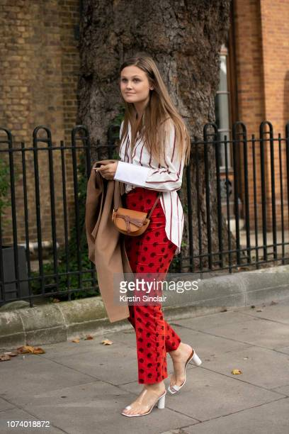 A guest wears Chloe trousers and a Loewe bag during London Fashion Week September 2018 on September 16 2018 in London England