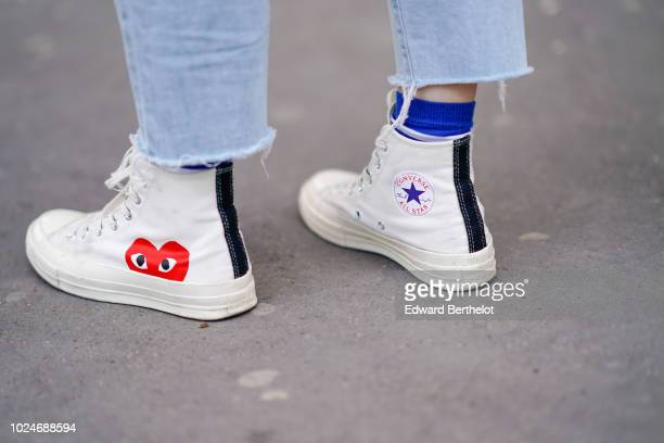 A guest wears Converse white sneakers shoes outside Juun J during Paris Fashion Week Menswear SpringSummer 2019 on June 22 2018 in Paris France