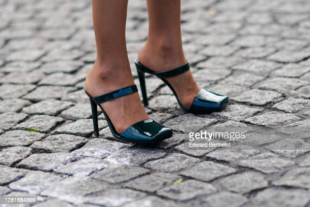 Guest wears dark green shiny shoes, outside Chanel, during Paris Fashion Week - Womenswear Spring Summer 2021, on October 06, 2020 in Paris, France.