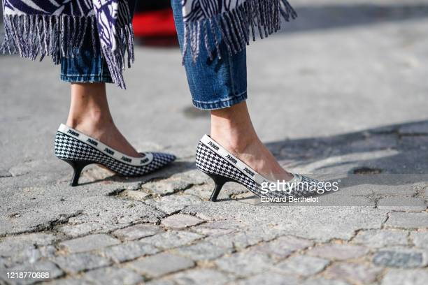 Guest wears Dior J'Adior pointy houndstooth pattern shoes, outside Dior, during Paris Fashion Week - Womenswear Fall/Winter 2020/2021, on February...